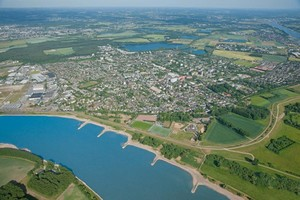 An aerial photo of Monheim am Rhein. The Rhine river is on teh left side.